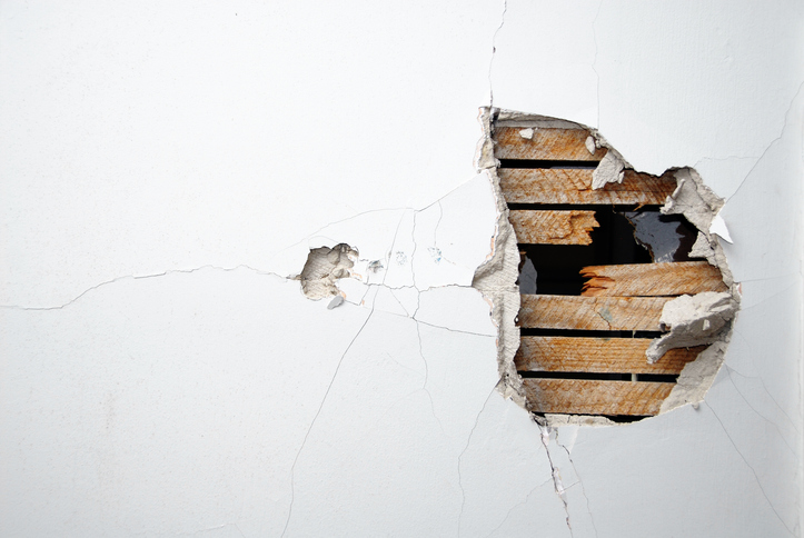 wall with a hole through it